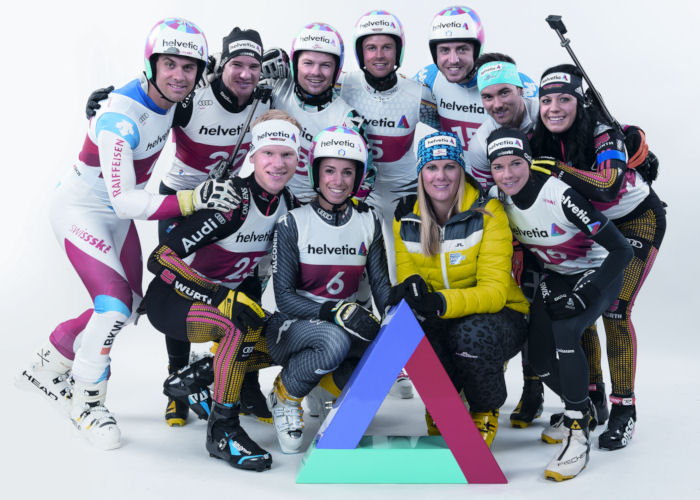 The athletes pose in two lines behind a Helvetia triangle.